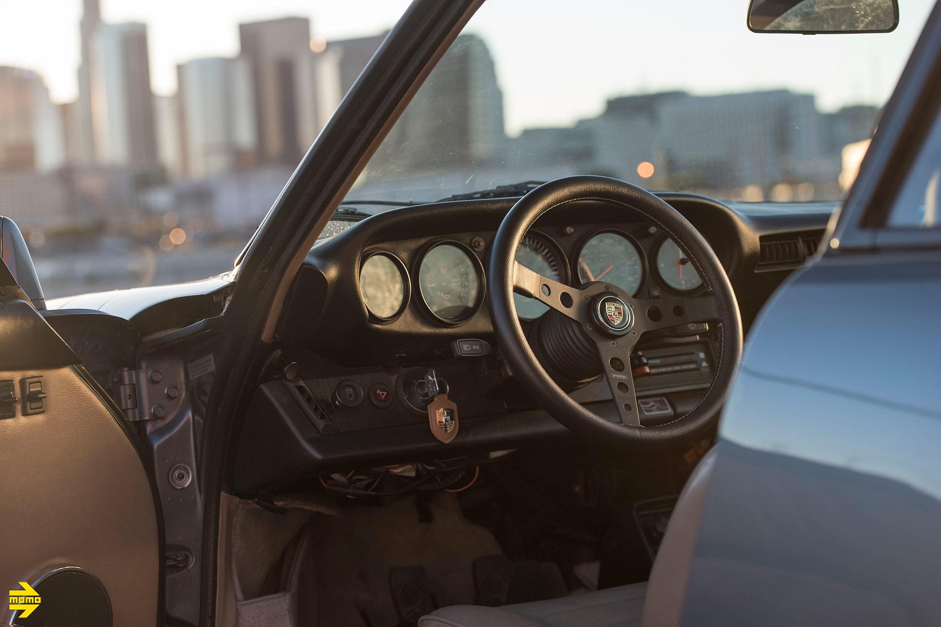 Blue Porsche 911 Super Carrera With A MOMO Prototipo Steering Wheel in Black