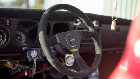 Red Datsun 510 Wagon - MOMO MOD. 69 Steering Wheel- MOMO SK-50 Shift Knob in Black