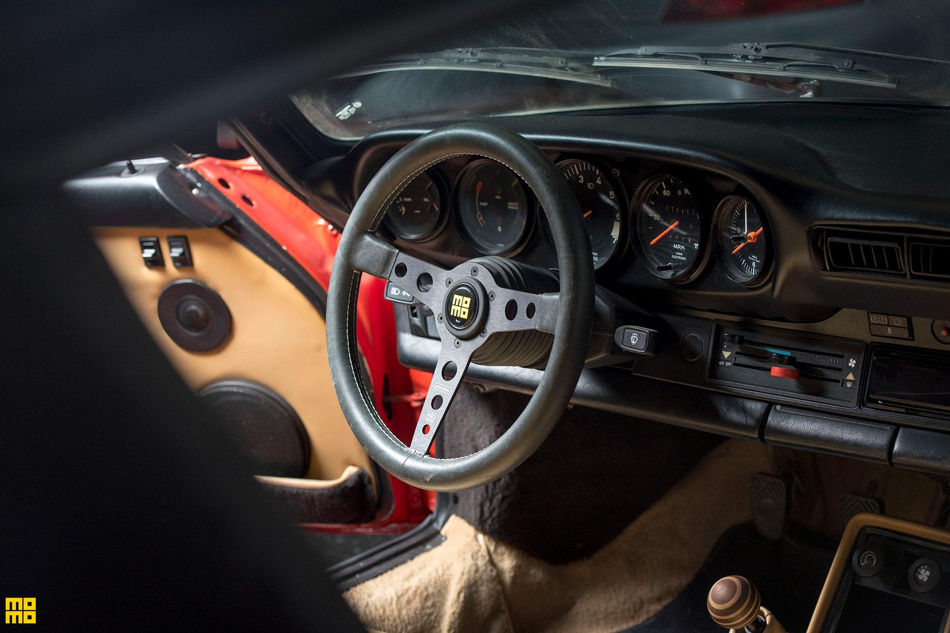 Guards Red Porsche 930 Turbo Slantnose - Momo Heritage Prototipo Steering Wheel in Black